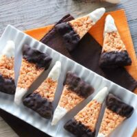 Chocolate Dipped Candy Corn Rice Krispie Treats are a fun and easy Halloween treat that the whole family will enjoy!