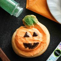 Orange Pumpkin Rolls - Pumpkin shaped orange rolls are decorated to look like jack-o-lanterns for Halloween.