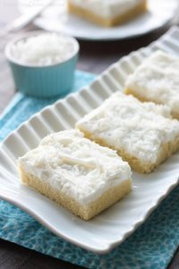 These Coconut Sugar Cookie Bars have lots of delicious coconut flavor from the crust, to the frosting, and the shredded coconut on top. Plus, they are super soft, chewy, and easy to make!