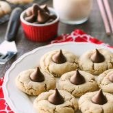 Peanut Butter Blossoms, Peanut Butter Kiss Cookies, and Peanut Butter Thumbprints are all one and the same. An easy and delicious soft peanut butter cookie with a large chocolate morsel center. Makes a great Christmas cookie to share with family and friends!