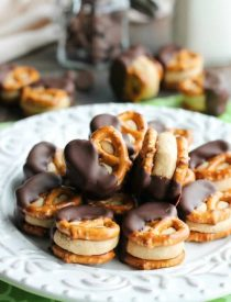 Peanut Butter Balls are made into pretzel bites for a salty-sweet addicting treat! Perfect for parties or Christmas neighbor gifts!