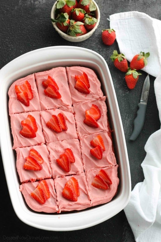 This strawberry cake uses fresh strawberries and flavored gelatin for a super flavorful strawberry sheet cake that will feed a crowd. It's really easy, and incredibly moist too!