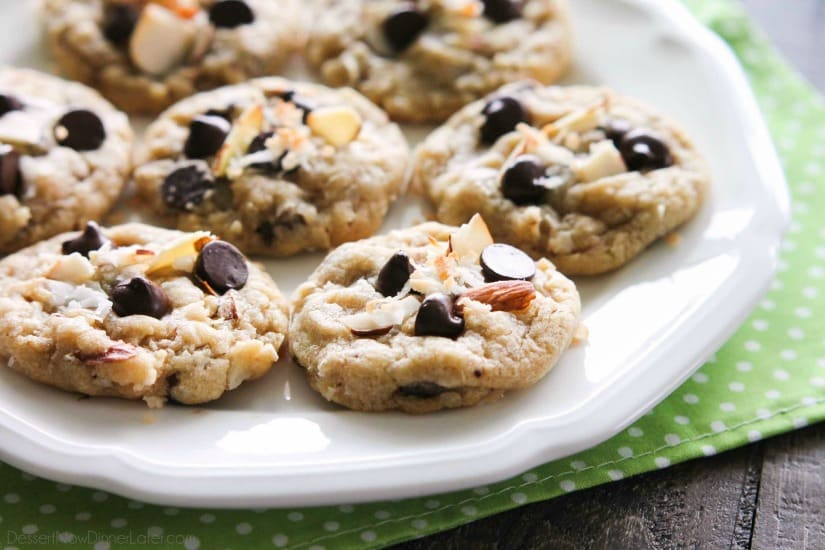 Almond Coconut Chocolate Chip Cookies are loaded with sliced almonds, shredded coconut, chocolate chips and flavored extracts for an Almond Joy inspired twist on the traditional chocolate chip cookie.