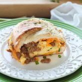 This Breakfast Stuffed French Bread is like a huge breakfast sandwich stuffed with soft scrambled eggs, meaty sausage, and sharp cheddar cheese inside a fresh baked loaf of French bread. (Substitute your favorite meats or cheeses to create your own!)