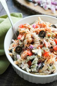 Bacon Ranch Pasta Salad is perfect for BBQ's and all your summer get togethers. It's loaded with pasta, bacon, cheese, olives, tomatoes, and onion then tossed with a simple, creamy ranch dressing.