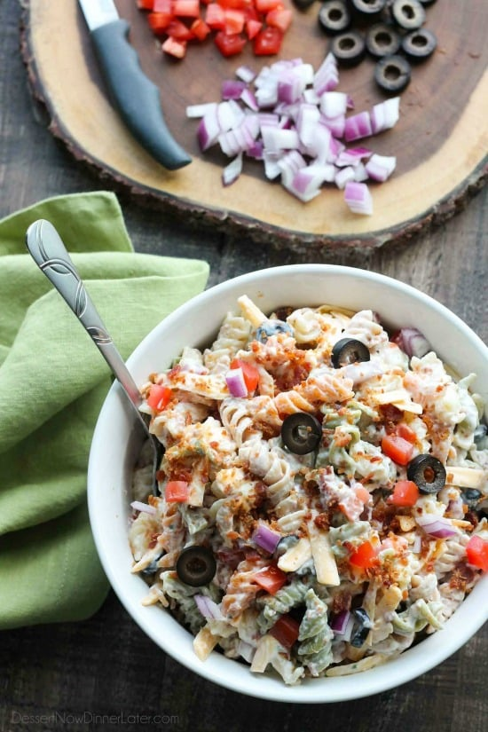 Bacon Ranch Pasta Salad is perfect for BBQ's and all your summer get togethers. It's loaded with pasta, bacon, cheese, olives, tomatoes, and onion - then tossed with a simple, creamy ranch dressing.