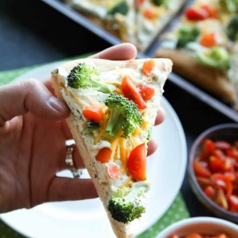 This cold vegetable pizza is the ultimate party appetizer for summer potlucks. With a fresh baked crust, creamy ranch spread, and crunchy fresh vegetables, everyone will be coming back for seconds!