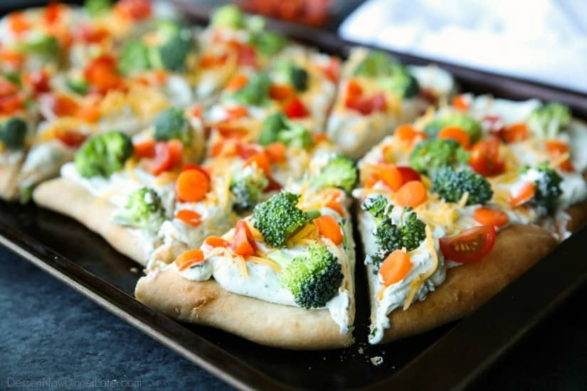 This cold vegetable pizza is the ultimate party appetizer for summer potlucks. With a fresh baked crust, creamy ranch spread, and crunchy fresh veggies, everyone will be coming back for seconds!