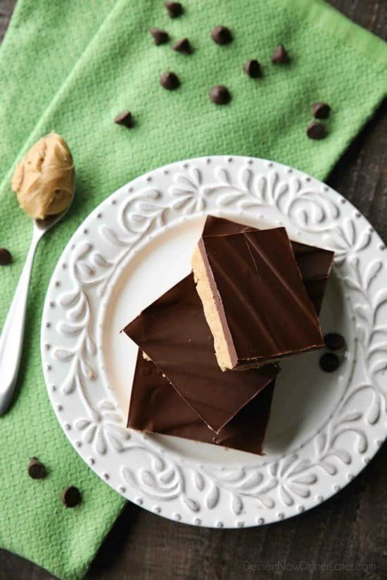 Easy No Bake Peanut Butter Bars taste a lot like a Reese's Peanut Butter Cup. The perfect party pleasing dessert with a sweet peanut butter base, and creamy chocolate ganache topping.
