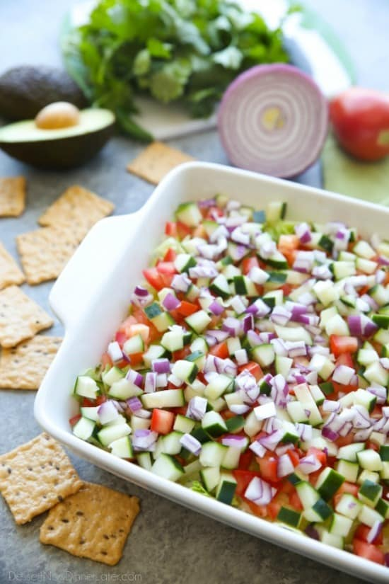 This Skinny Seven Layer Dip is loaded with fresh veggies, and makes a great appetizer or snack for any party or barbecue!