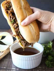Instant Pot French Dip Sandwiches are full of fork-tender beef roast cooked in a flavorful broth that makes the perfect au jus dipping sauce. A family favorite, easy pressure cooker dinner!