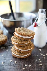 Oatmeal Cream Pies - Soft and chewy oatmeal cookies filled with vanilla buttercream frosting. Inspired by Little Debbie, but made fresh and delicious in your own home!