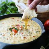 This Queso Dip is classic! Make it mild or hot, chunky or smooth. It's extremely versatile and made with simple ingredients. No Velveeta! A tasty appetizer or snack for game day or any party gathering!