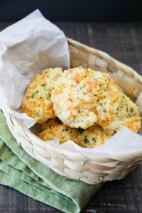 This copycat Red Lobster Cheddar Bay Biscuits recipe is super delicious! Crisp edges, a fluffy biscuit center, with plenty of cheese, garlic, and extra butter slathered on top. You won't be able to eat just one!