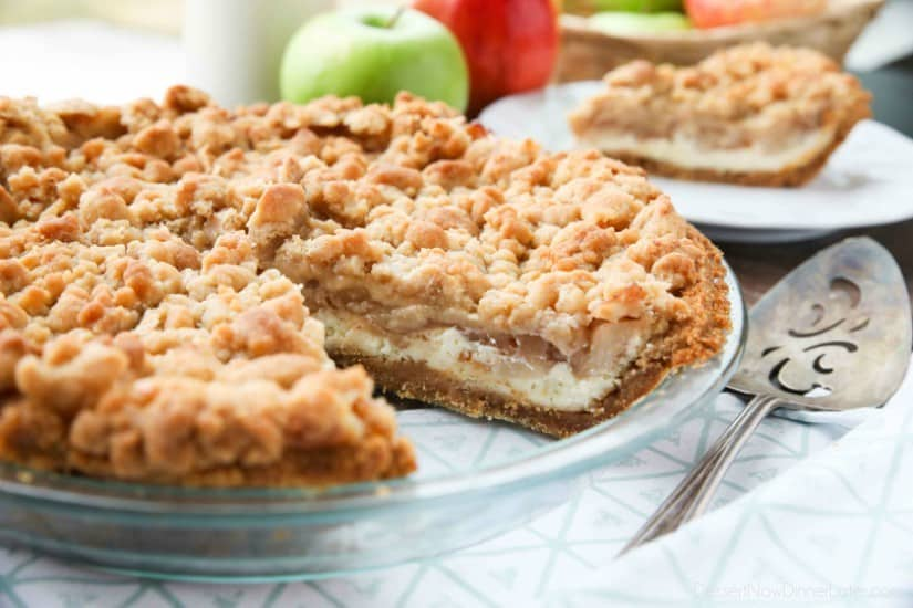 Apple Streusel Cheesecake Pie combines two dessert favorites with a graham cracker crust, creamy cheesecake layer, homemade apple pie filling, and crunchy streusel topping.