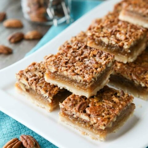 Pecan Pie Bars are made with an easy shortbread crust and delicious pecan pie filling. A crowd-pleasing Thanksgiving or Christmas dessert that will serve many guests.