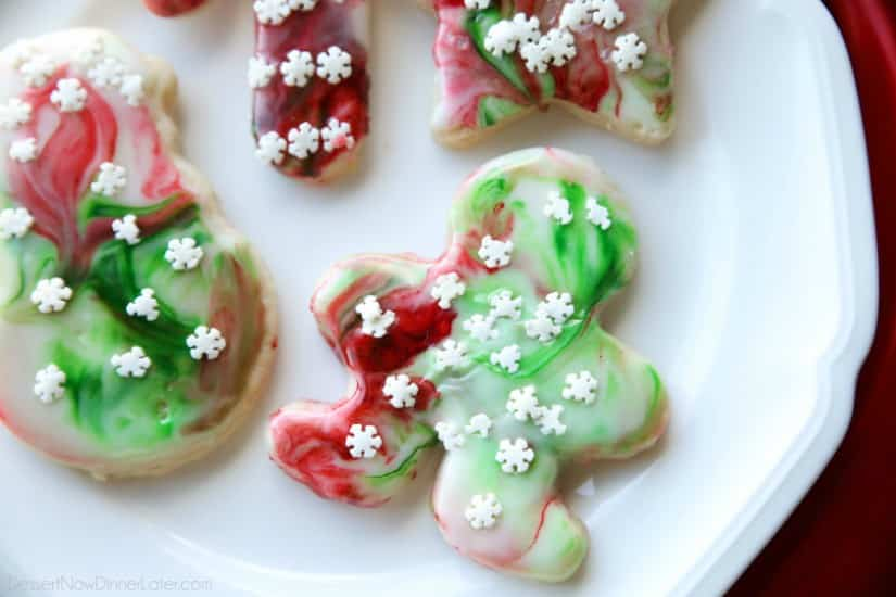 Swirled Christmas Sugar Cookies make cookie decorating easy! Simply swirl food coloring in a special glaze and dip the cookie! The kids will love making these for Santa!