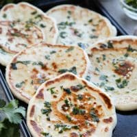 This buttery Garlic Naan flatbread is made easy with store-bought frozen dough. Enjoy restaurant-style Indian bread with dinner anytime, it's so easy!