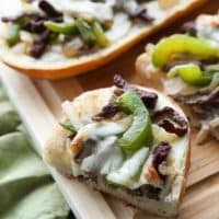 Philly Cheesesteak French Bread is a delicious open-faced sandwich with plenty of juicy meat, crisp veggies, and melty cheese for an easy dinner that is sure to satisfy!
