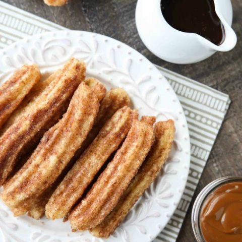 This churros recipe is super easy to make with a simple churro dough that is piped into oil and fried, then coated in cinnamon-sugar. You can enjoy these crisp, yet soft homemade churros anytime!