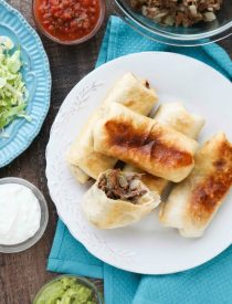 Instant Pot Chimichangas are a favorite family dinner with tender shredded beef, seasoned to perfection, and wrapped in tortillas to fry or bake. (+ Recipe Video!)