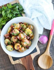 There's no mayo in this flavorful Bacon Potato Salad that's dressed with an easy garlic and honey-mustard vinaigrette. Delicious warm or cold, you'll enjoy making this zesty Bacon Potato Salad for picnics, potlucks, parties, and events!