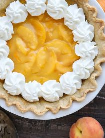 This Fresh Peach Pie has a no-bake filling that uses fresh, uncooked peaches and a simple homemade glaze inside of a crisp pie crust. A great recipe for fresh peaches!