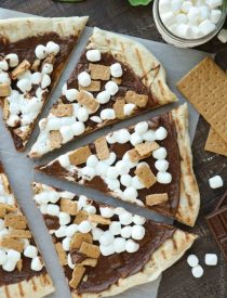 Make your dessert outside! This Grilled S'mores Pizza is an easy and delicious dessert with all the flavors of everyone's favorite campfire treat!
