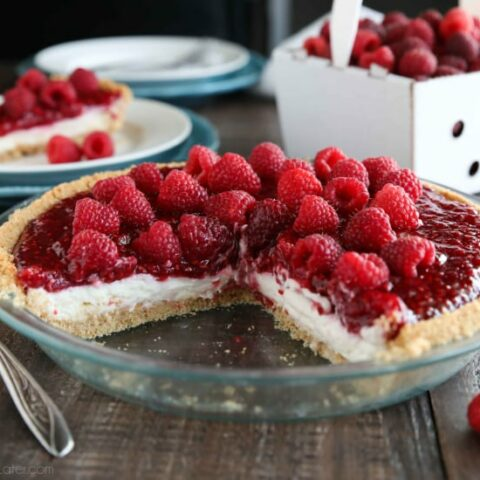 Raspberry Cream Pie has layers of no-bake cheesecake and an easy raspberry pie filling inside of a vanilla wafer crust. It's not too sweet, not too tart, is perfectly light and satisfying, and can be made year round with fresh or frozen raspberries.