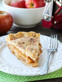 This homemade apple pie recipe has a flaky pie crust with cinnamon-sugar sprinkled on top and an extra fruity apple pie filling with just the right amount of sauce.