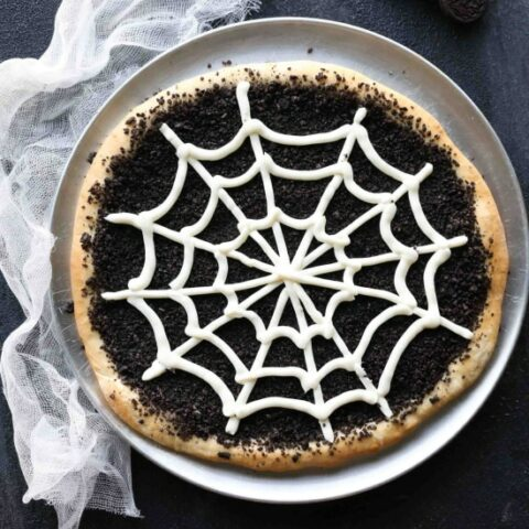 This Cobweb Oreo Dessert Pizza is an easy and fun Halloween party food that will be enjoyed by guests of all ages.