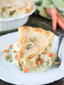 This classic Chicken Pot Pie is made from scratch with a creamy and flavorful chicken and vegetable filling tucked inside of a flaky pastry crust. Homemade comfort food that the whole family loves!