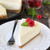 This Classic Cheesecake recipe is smooth, creamy, moist, and full of vanilla, with a graham cracker crust. Plus all the tips and tricks for the perfect cheesecake with no cracks! A great dessert for the holidays or any occasion.