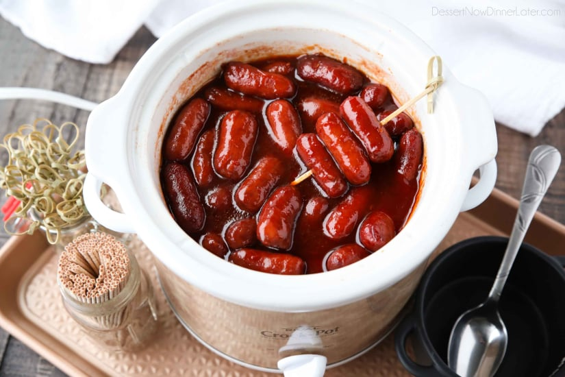 Crockpot Little Smokies is an easy appetizer for parties, the big game, or holidays. Only three ingredients and a slow cooker is all you need for these cocktail sausages. The sweet and tangy sauce is great on meatballs too!
