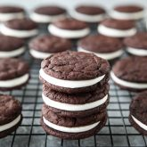 These easy Homemade Oreos are made completely from scratch. Soft, fudgy chocolate cookies are stuffed with a simple, vanilla cream filling. (Cream Cheese Frosting recipe also available for filling.)