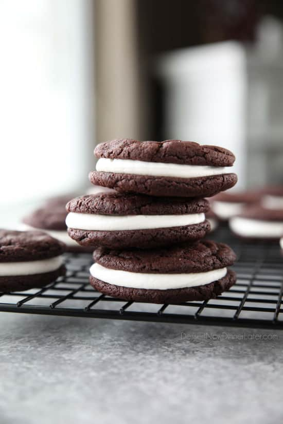 These easy Homemade Oreos are made completely from scratch. Soft, fudgy (brownie-like) chocolate cookies are stuffed with a simple, vanilla cream filling. (Cream Cheese Frosting recipe also available for Oreo filling.)