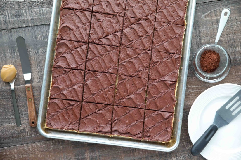 These Peanut Butter Bars with oatmeal are a soft and chewy baked cookie dessert topped with an extra layer of peanut butter, and a decadent chocolate frosting. Perfect for parties and potlucks! (Serves a crowd.)