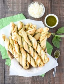 These easy Pesto Breadsticks are soft and flavorful with savory basil pesto and cheesy mozzarella twisted inside. A great appetizer or side for soup, salad, or pasta.