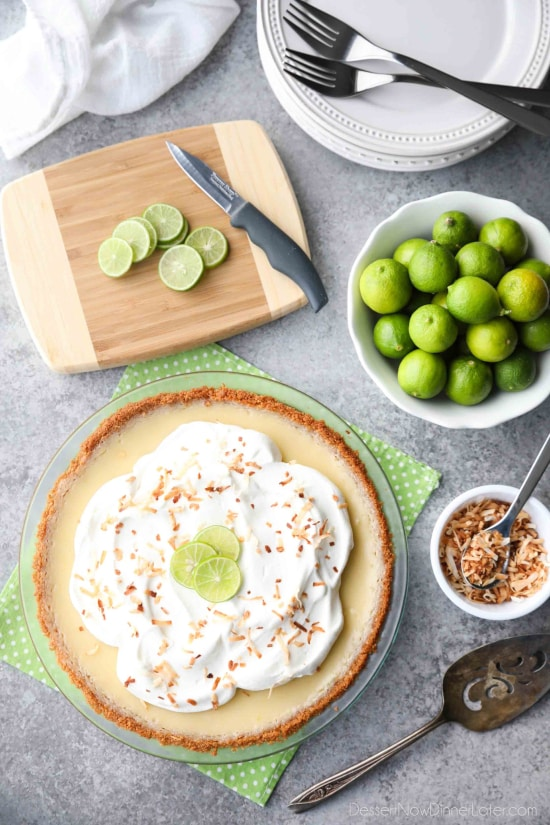Coconut Key Lime Pie has coconut in the crust, cream of coconut in the key lime filling, and toasted coconut on top! A tropical dessert that's creamy, sweet, and tart.