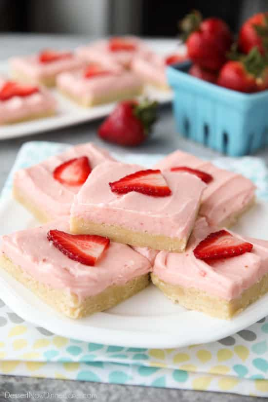 Strawberry Sugar Cookie Bars - soft, moist sugar cookie bars are topped with a natural strawberry frosting. Super easy to make and serves a crowd!