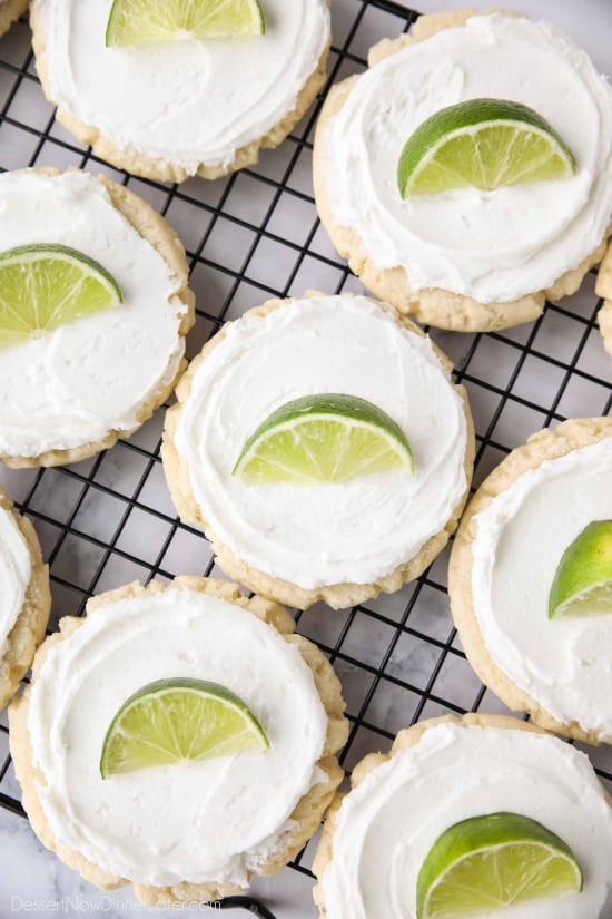 Coconut Lime Sugar Cookies - an easy sugar cookie recipe with a tropical fruit twist. You'll love these moist sugar cookies with a hint of lime, creamy coconut frosting, and a fresh lime wedge to squeeze on top. A Twisted Sugar copycat recipe.