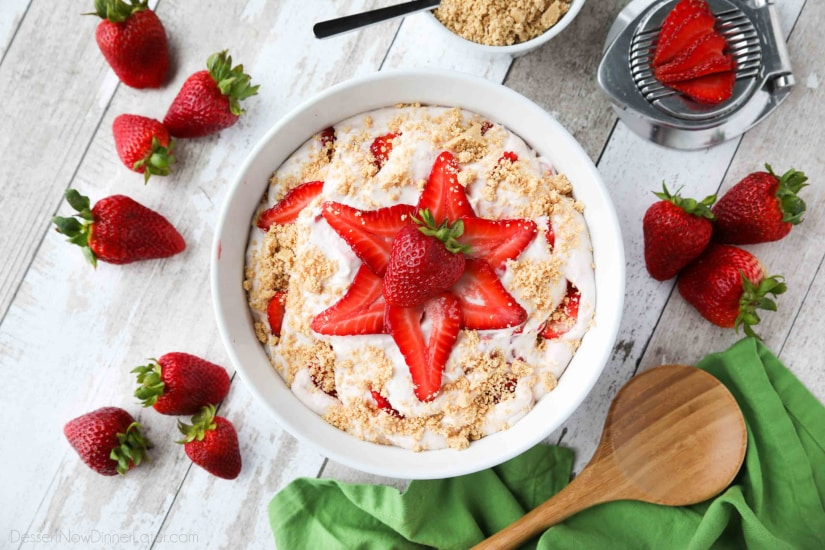 Strawberry Cheesecake Salad is loaded with cream cheese, jello pudding, yogurt, fresh strawberries, and whipped topping then sprinkled with a graham cracker crust. It's a delicious potluck salad, fluff salad, or decadent fruit salad that doubles as a dessert.