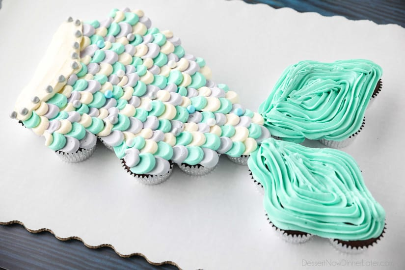 This Mermaid Tail Cupcake Cake is the perfect girls birthday cake, and this tutorial shows you exactly how to make it. Cupcakes pull apart for easy serving. (No cake to cut!)