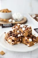 S'mores Krispie Treats have all the flavors of traditional s'mores made into an easy no-bake summer dessert. Loaded with Golden Grahams cereal, plenty of marshmallows and chocolate, these indoor s'mores bars are a crowd favorite.