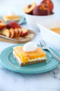 This Peaches and Cream Dessert has a pecan shortbread crust, no-bake cheesecake filling, and fresh peach layer on top. It's a delicious light and fruity summer dessert.