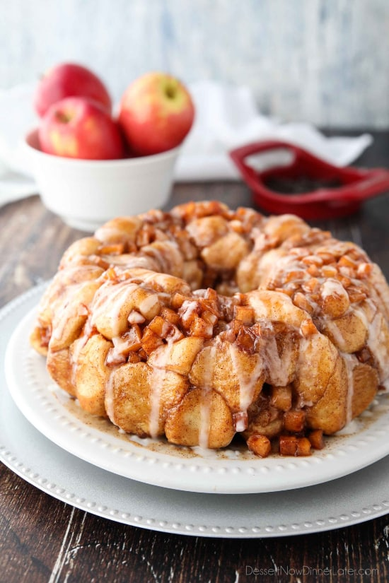 Apple Fritter Monkey Bread is an easy and delicious pull apart bread with chunks of caramelized apples, sticky cinnamon-sugar, and a light glaze. Fashioned after your favorite donut, this apple fritter bread makes a tasty breakfast or dessert.