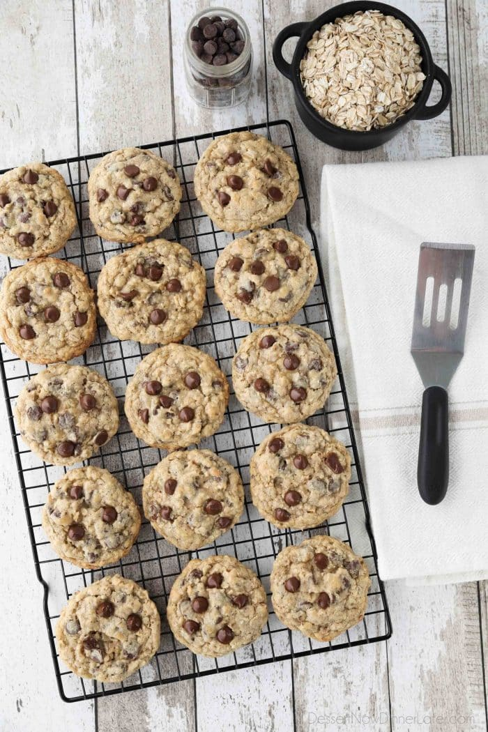 These Oatmeal Chocolate Chip Cookies are thick, soft, and chewy, with plenty of hearty old fashioned oats and creamy chocolate chips. An easy classic recipe.