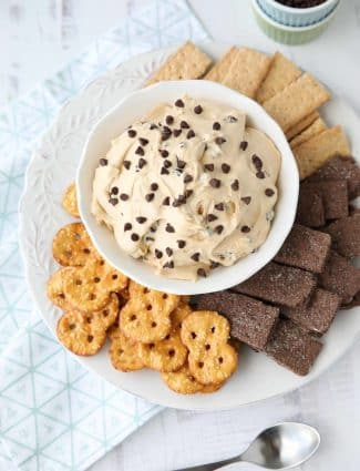This buckeye dip recipe uses all the ingredients of your favorite buckeye peanut butter balls. With cream cheese, and mini chocolate chips, it's an easy, smooth and creamy dip. Serve it with pretzels, honey and chocolate graham crackers, or even apples. This dip is perfect for parties, holidays, or game day!