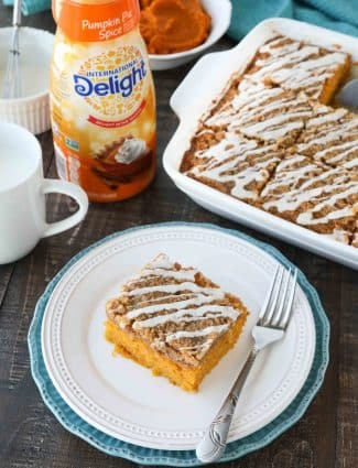 Pumpkin Spice Coffee Cake is easy to make and full of real pumpkin and fragrant spices. It's moist, yet light and fluffy, with a cinnamon crumb topping and pumpkin spice glaze on top.