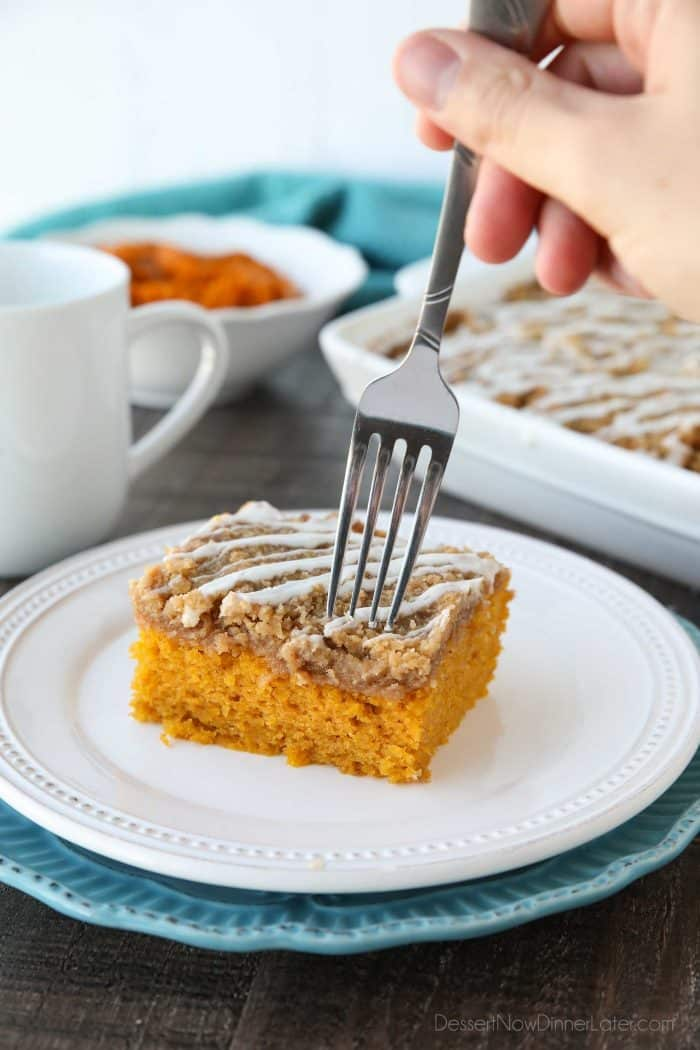 Pumpkin Spice Coffee Cake is easy to make and full of real pumpkin and fragrant spices. It's moist, yet light and fluffy, with a cinnamon crumb topping and pumpkin spice icing on top.